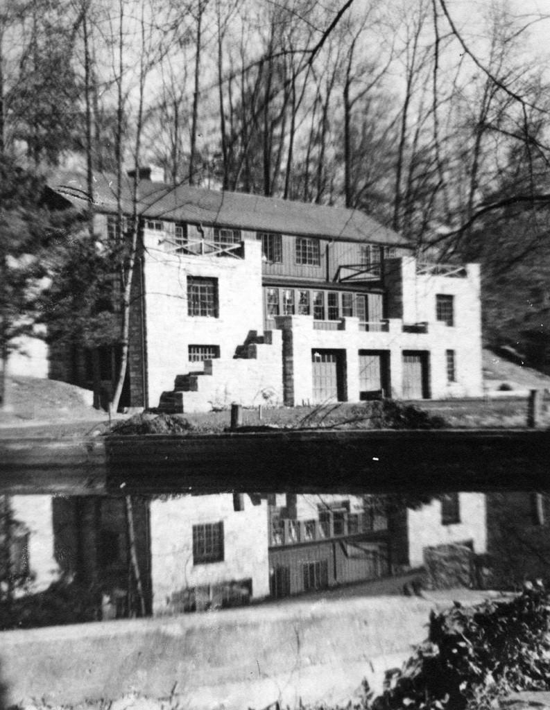 Original appearance of the Jesse Preston Draper Industrial Building, reflected in the swimming pool, c. 1937.[II_6_swimming_draper_boys_239a]