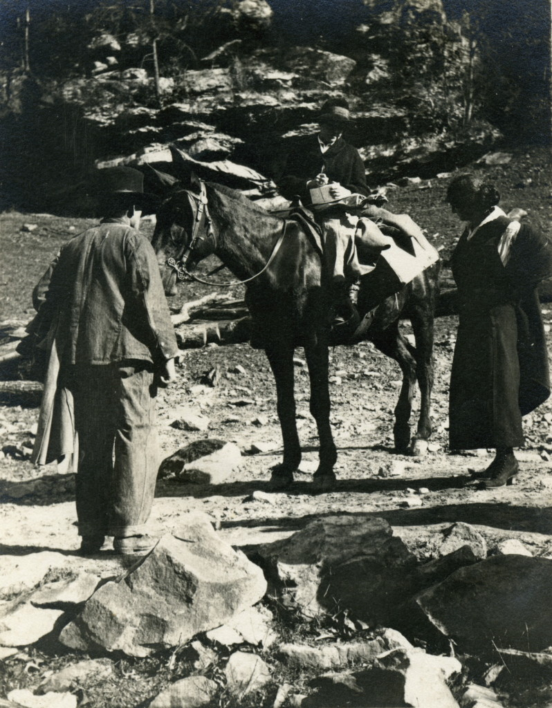 Miss Katherine Pettit, seated on horse with man and woman standing nearby on road below Indian Cliff dwelling at School entrance. X_099_workers_2494_mod.jpg