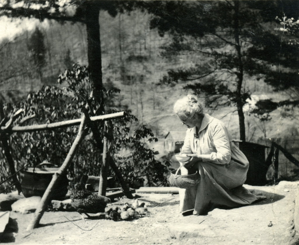 Harriet Butler feeding chicken and chicks at iron pot cooker at Medical Settlement, Big Laurel. X_099_workers_2497_mod.jpg